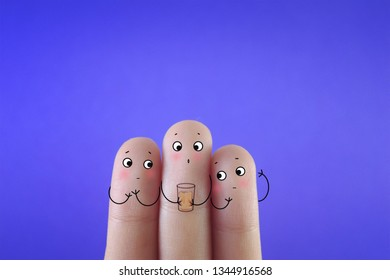 Three fingers decorated as three friends. One of them is holding a glass with contaminated water.
