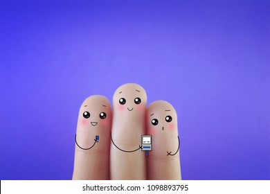 Three fingers decorated as three person checking their glucose level.