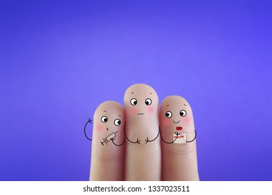 Three fingers decorated as three person. One of them is receiving insulin injection.