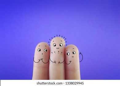 Three fingers decorated as three person. One of them is doing acupuncture.
