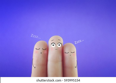 Three fingers decorated as three person. One of them is having insomnia. Suitable to be used for anything about sleeping disorder.