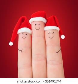 Fingers Faces Santa Hats Against Red Stock Photo (Edit Now ...