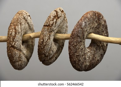 three finnish round rye bread on a neutral background