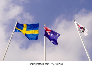 Three flag and nice sky.