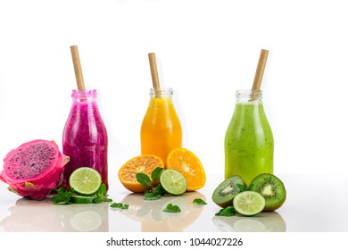Three flavours of fruit juice in bottles with a straw on white background
