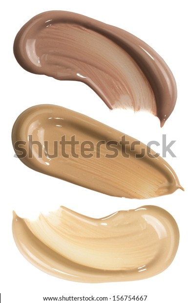 Three foundation swatches isolated on white
