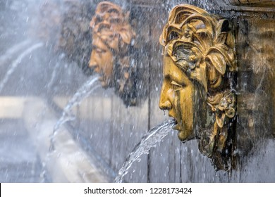 three fountains heads, gargoyle with water, drop on nose, blurred  background, Peterhof, Saint Petersburg, Russia.