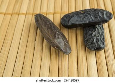 Three fragrant tonka beans