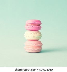 Three french macaroons over mint background