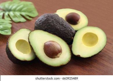 Three fresh avocado on wood background/ Avocado
