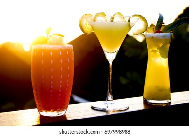 Three Fresh fruit cocktails drinks at sunset in a resort in Phuket Island, Thailand