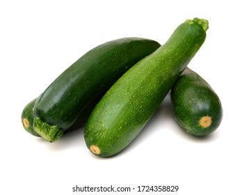 Three fresh green zucchini isolated on white background