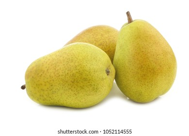three fresh Lucas pears on a white background