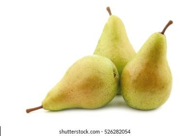 three fresh migo pears on a white background