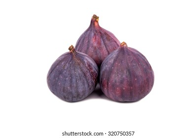 Three fresh and ripe figs isolated on white background