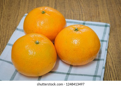 Three Fresh Ripe and Sweet Oranges on A Wooden Table, Orange Is The Fruit of The Citrus Species.