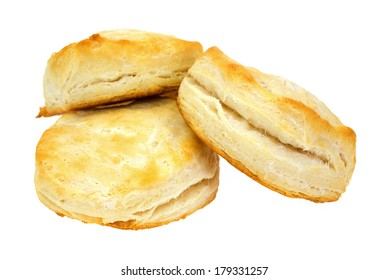 Three freshly baked buttermilk biscuits on a white background.