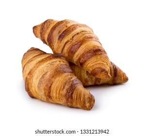 Three freshly baked croissants isolated on white background