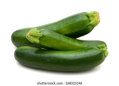 three freshly green zucchinis on white background