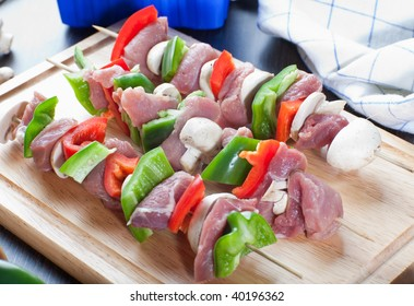 Three freshly made broaches with meat and veggies on wooden bread board