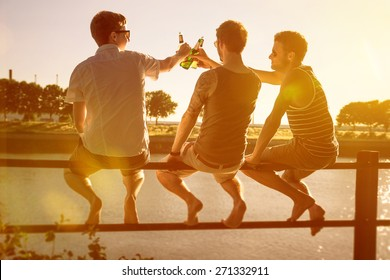 Three friends drinking beer