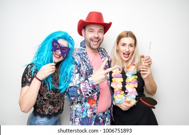 three friends girls pose photo booth shoot party studio wedding drunk props happy camera
