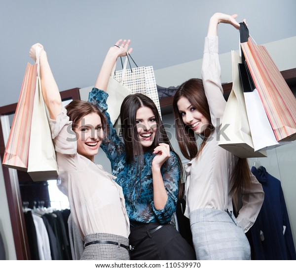 Three friends are happy after shopping