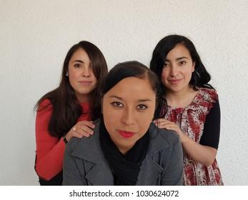 three friends happy posing