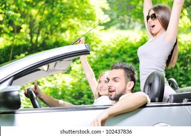 Three friends in a sports car