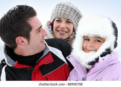 Three friends stood in snow