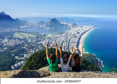 Three friends at the summit of The Two Brothers Hill (Morro Dois Irmãos), Rio de Janeiro City