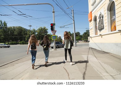 Three friends are walking around the city. Place is near of the central square of Chisinau Republic of Moldova July 2 2018.