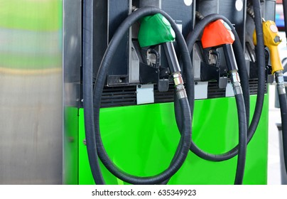 Three fuel nozzle at gas station