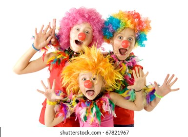 Three funny clowns in colorful wigs