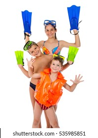 Three funny kids in diving mask standing together, isolated on white