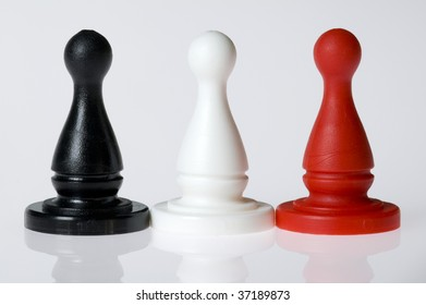 Three game pieces standing in a row on a white background.