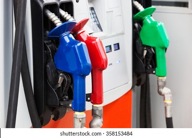 three gas hoses on a modern gas station