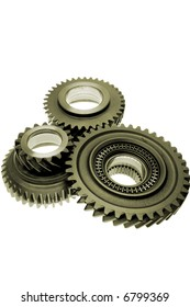 Three gears over white