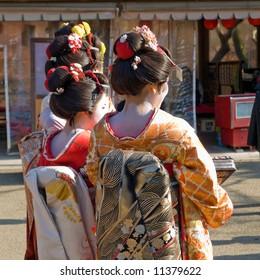 Three Geisha standing together at Kiyomizu temple in Kyoto, Japan