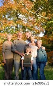 Three generation family in autumn setting