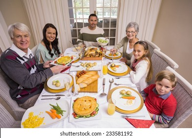Three generation family during christmas dinner together at home in the living room