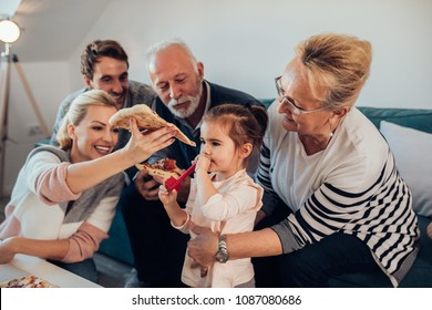 Three generation family having pizza together