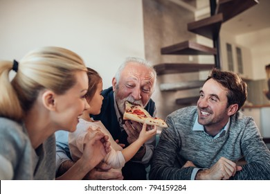 Three generation family having pizza together