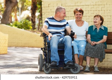 Three generation family sitting together in the park