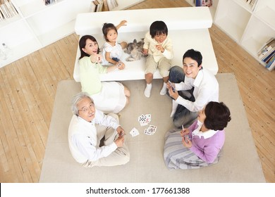 Three generation Japanese family playing cards