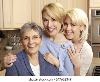 Three generations of beautiful women smiling in a kitchen