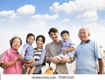 three generations family standing together outdoors