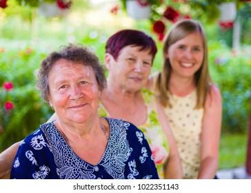 Three generations portrait, caucasian women in a row.