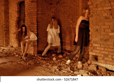 Three ghosts of young girls in abandoned building