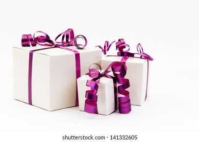 Three Gift Boxes with Pink Ribbon